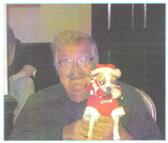Christmas-2011, A PICTURE OF ME HOLDING MY FAVORITE DOG A CHIHUAHUA 
